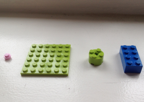 What's the tallest Lego building you can make with these 4 pieces?